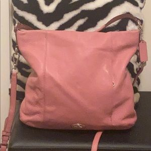 Coach purse with zipper closure and shoulder strap